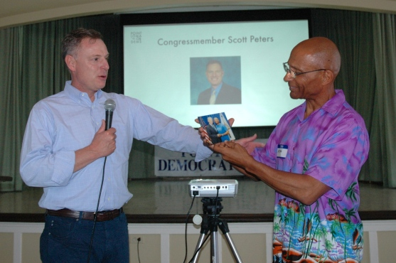 Scott Peters presented Mike Johnson with framed photograph of Mike and Joe Biden