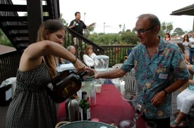 Gretchen Newson, Secretary Point Loma Democratic Club pouring a beer for Scott Strohecker
