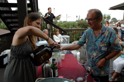 Gretchen Newson, Secretary Point Loma Democratic Club pouring a beer for Scott Strohecker