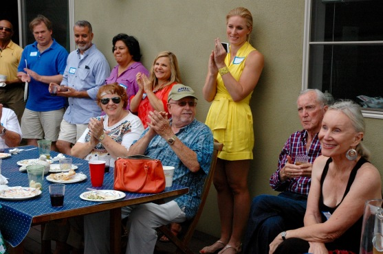 Club members applaud Gerry Halpern for hosting the event at her beautiful home