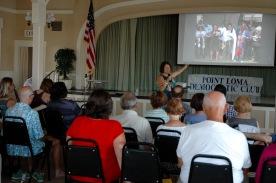 Rabbi Laurie Coskey talking to members